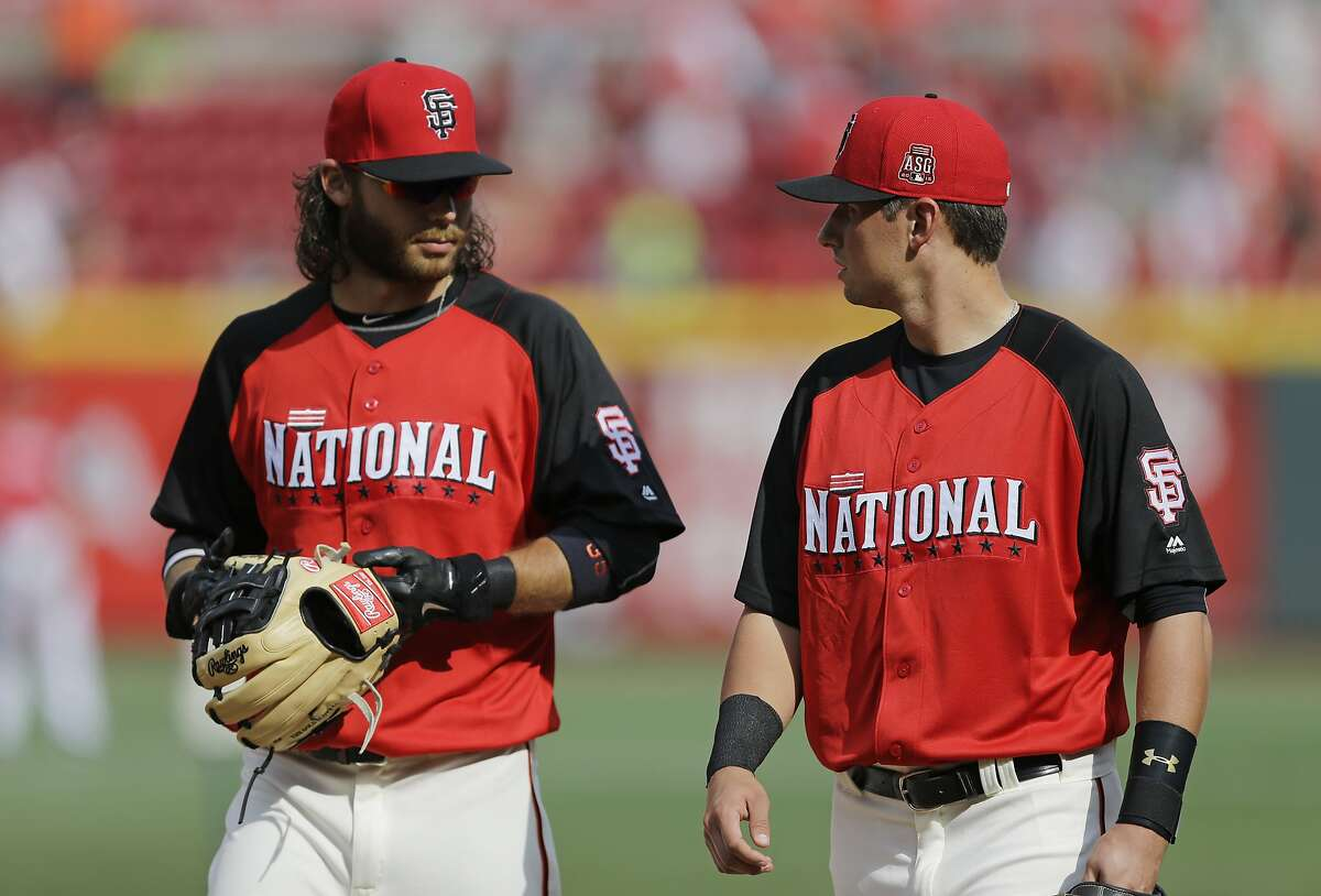 National League's Brandon Crawford, left, and Joe Panik, both of the San Francisco Giants, talk during batting practice for the MLB All-Star baseball game, Monday, July 13, 2015, in Cincinnati. (AP Photo/Jeff Roberson)