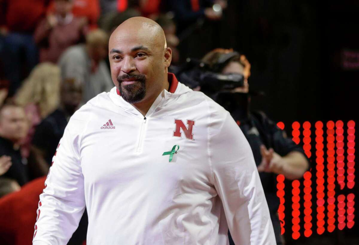 FILE - In this Jan. 27, 2018, file photo, Jovan Dewitt, Nebraska football outside linebackers and special teams coach, is introduced to fans at halftime of an NCAA college basketball game against Iowa, in Lincoln, Neb. Dewitta€™s happy place is on the practice field, and hea€™s never appreciated being there as much as he does now. Dewitt is back at his job as Nebraskaa€™s outside linebackers coach and special teams coordinator following intense treatments for throat cancer that caused him to lost 102 pounds and zapped most of his energy. (AP Photo/Nati Harnik, File)