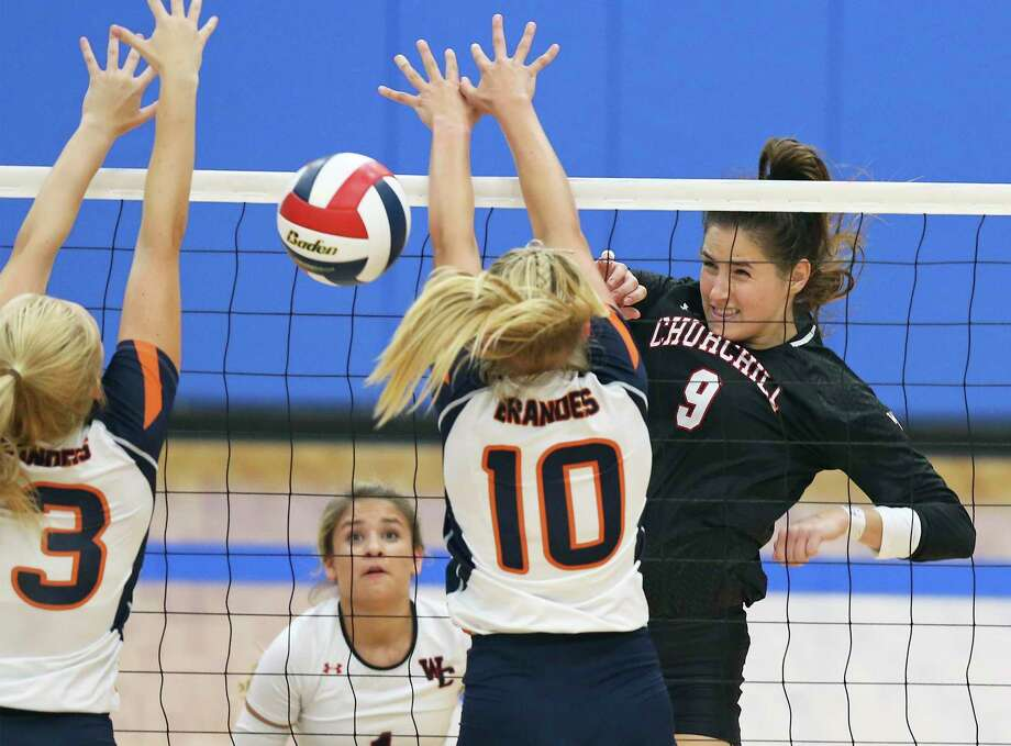 Isabel Fichtel crams the ball between Bears defenders as Brandeis hosts Churchill in the season opening volleyball match at Northside Sports Gym on August 6, 2019. Photo: Tom Reel, Staff / Staff Photographer / 2019 SAN ANTONIO EXPRESS-NEWS