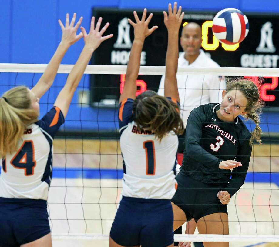 Shayla Garrison moves the ball around Bears defenders as Brandeis hosts Churchill in the season opening volleyball match at Northside Sports Gym on August 6, 2019. Photo: Tom Reel, Staff / Staff Photographer / 2019 SAN ANTONIO EXPRESS-NEWS