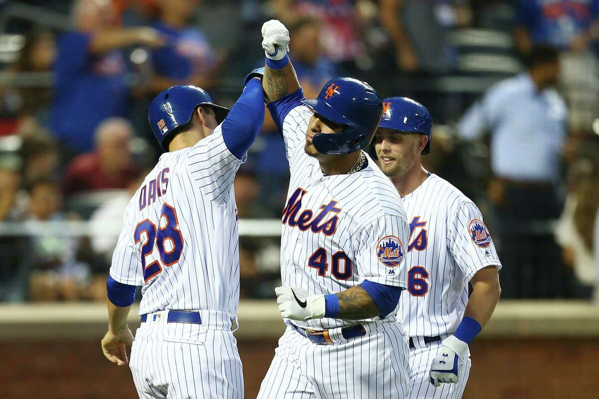 NEW YORK, NEW YORK - AUGUST 06: Wilson Ramos #40 of the New York Mets celebrates with J.D. Davis #28 after hitting a 2-run home run to center field in the third inning against the Miami Marlins at Citi Field on August 06, 2019 in New York City. (Photo by Mike Stobe/Getty Images)