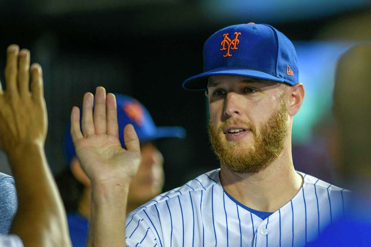 New York Mets starting pitcher Zack Wheeler its congratulated in the dugout after being removed from a baseball game during the sixth inning against the Pittsburgh Pirates, Friday, July 26, 2019, in New York. (AP Photo/Corey Sipkin)