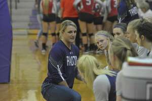 First-year PN-G head coach Brittany Fruge speaks to her players on the sideline during a 3-0 sweep of Bridge City on Tuesday night in Port Neches. Photo by Matt Faye/The Enterprise