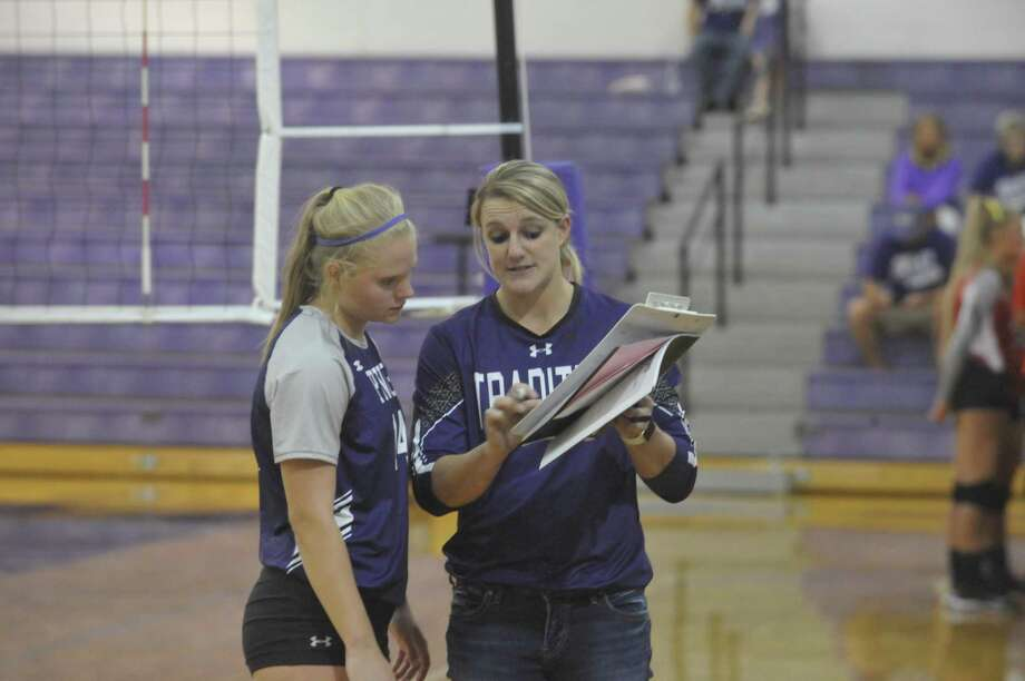 First-year coach Brittany Fruge gives instructions to senior Kaylee Hooper during Tuesday's season-opening win over Bridge City. Photo by Matt Faye/The Enterprise. Photo: Matt Faye/The Enterprise / Matt Faye/The Enterprise/