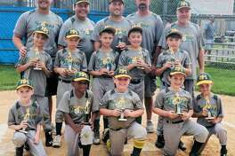 The New Milford 8U Baseball Travel Team, NM Storm, recently finished its first travel season playing in the Beth Wood Friendship League. In its inaugural year, the Storm had seven wins and one loss in the regular season, and had three wins in the playoffs to become National League Champions, advancing them to the championship game against the American League Champions (Newtown). There, the team finished a strong runner-up in a talented league of 20 teams. Above are, from left to right, in front, Henry Keuper, Mario Brito Trinidad, Kenny Staller, Rylan Lasser and Tyler Pacileo middle row, Willy Armstrong-Brown, Max Bonnell, Blake Olsen, Jack Leonard and Caden Lathrop; and in back, coaches Jack Hayes and Chip Leonard, manager Greg Lasser and coaches Kenny Olsen and Kenny Staller. Missing are Tyler Gude and Peter Farquharson Jr.