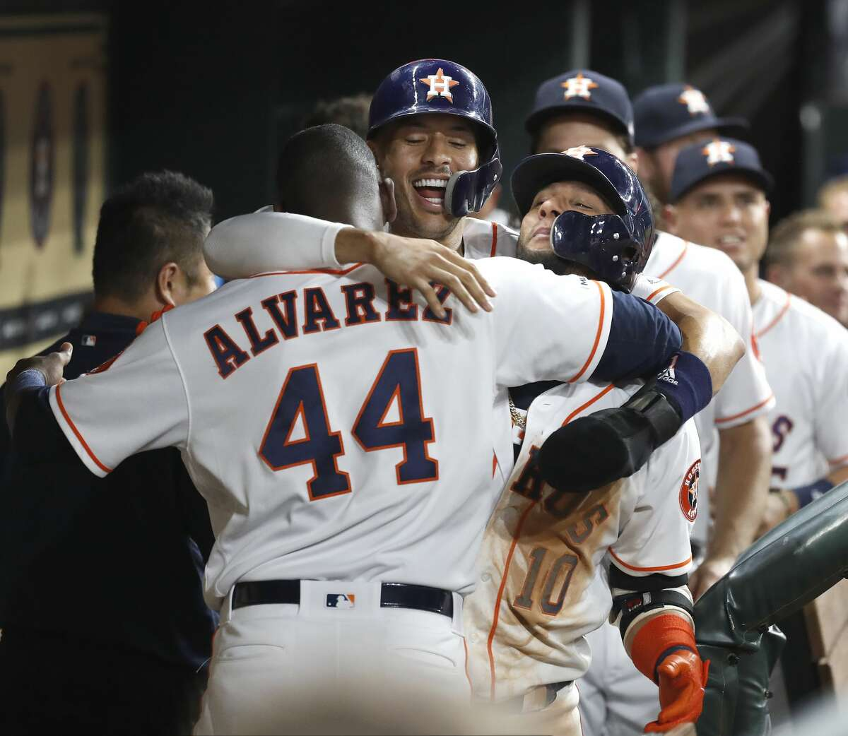A group hug with Yordan Alvarez (44) and Carlos Correa (1) after Yuli Gurriel's second home run of the night during the seventh inning of an MLB baseball game at Minute Maid Park, Tuesday, August 6, 2019.