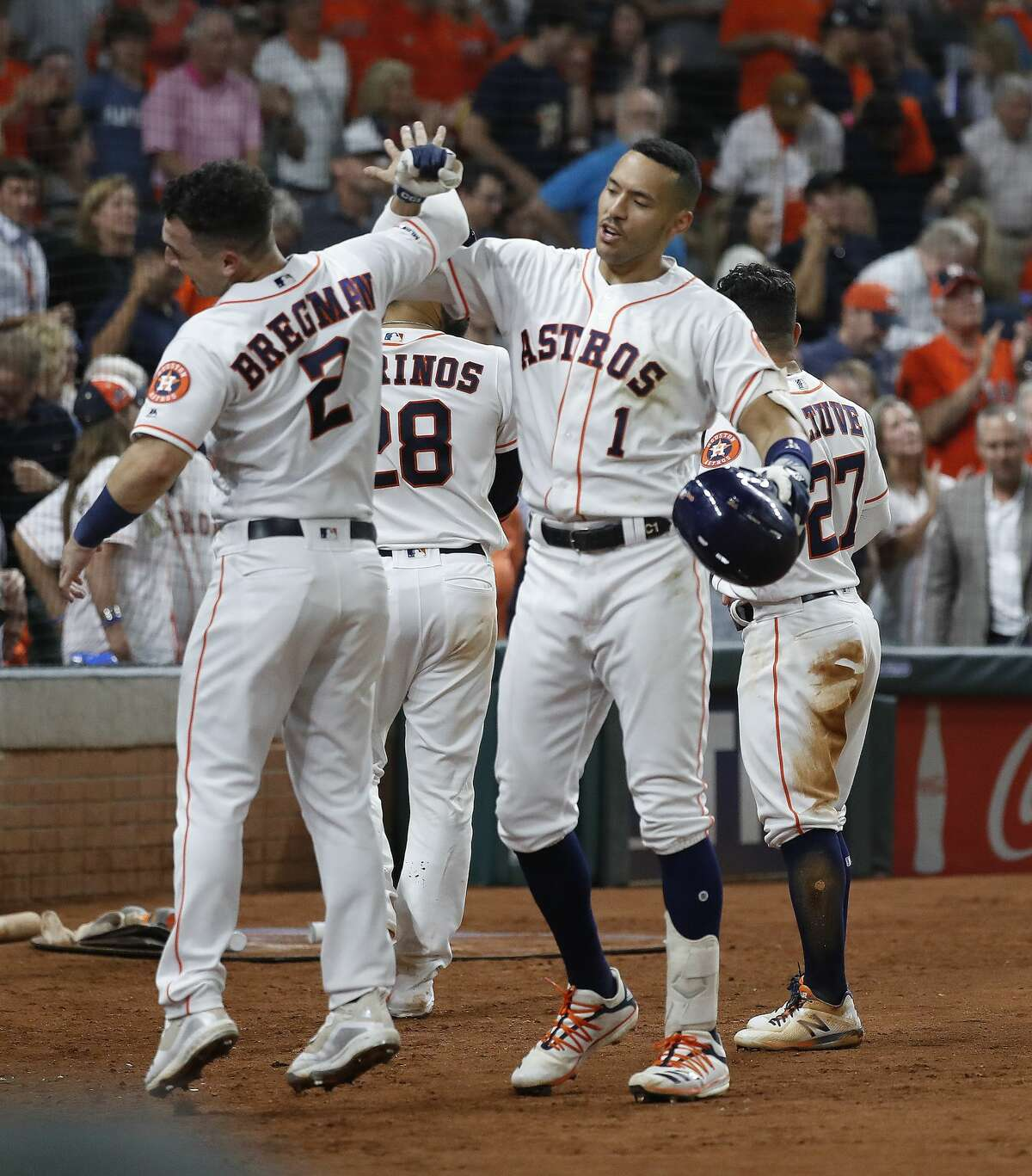 Houston Astros Carlos Correa (1) celebrates his home run with Alex Bregman (2)during the sixth inning of an MLB baseball game at Minute Maid Park, Tuesday, August 6, 2019.