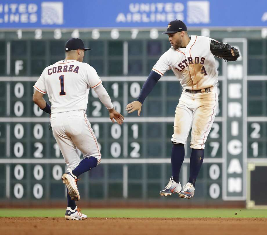 Houston Astros center fielder George Springer (4) and shortstop Carlos Correa (1) celebrate after the Astro beat the Colorado Rockies 11-6 after an MLB baseball game at Minute Maid Park, Tuesday, August 6, 2019. Photo: Karen Warren/Staff Photographer