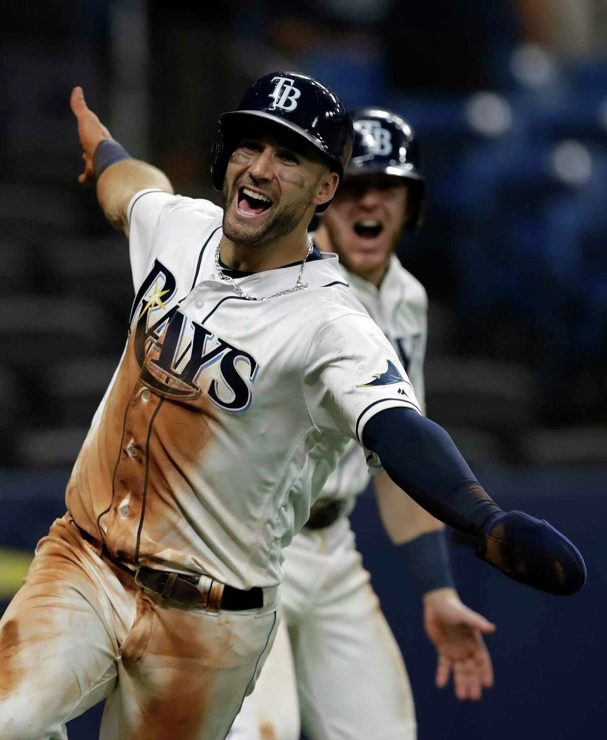 Tampa Bay Rays' Kevin Kiermaier celebrates after scoring the winning run on a wild pitch by Toronto Blue Jays reliever Buddy Boshers during the 10th inning of a baseball game Tuesday, Aug. 6, 2019, in St. Petersburg, Fla. (AP Photo/Chris O'Meara)