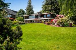 With its own dock and beach, this retro timepiece in Seward Park is timeless.... asking $3.6M