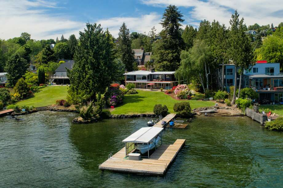 With its own dock and beach, this retro timepiece in Seward Park is timeless.... asking $3.6M Photo: Spencer Redford