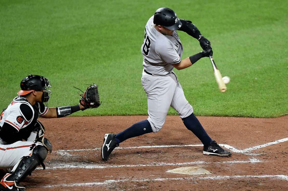 BALTIMORE, MD - AUGUST 06: Austin Romine #28 of the New York Yankees hits a two-run double in the fourth inning against the Baltimore Orioles at Oriole Park at Camden Yards on August 6, 2019 in Baltimore, Maryland. (Photo by Greg Fiume/Getty Images)