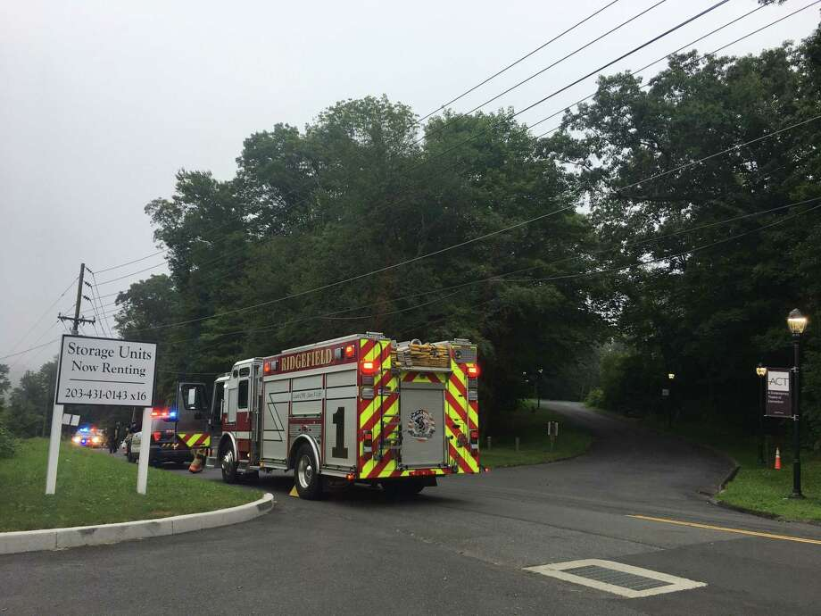 A Ridgefield fire engine arrives at the scene of a downed power line on Old Quarry Road Wednesday, Aug. 7. Photo: Stephen Coulter