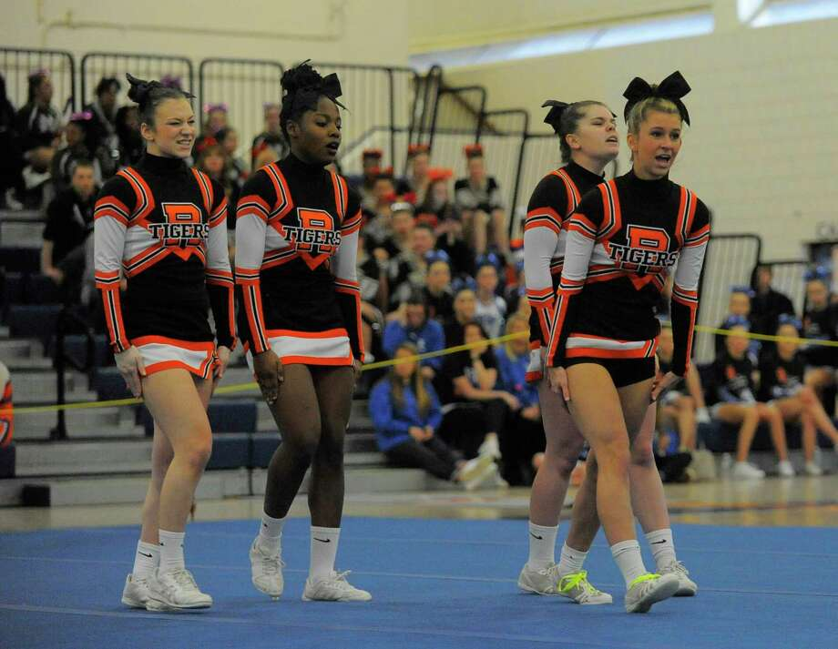 Ridgefield cheer competes during the FCIAC Cheerleading Championship at the Wilton Field House in Wilton, Conn. on Feb. 6, 2016. Photo: Matthew Brown / Hearst Connecticut Media / Stamford Advocate
