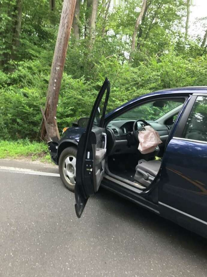 A telephone pole was replaced Tuesday afternoon after a car went off the road and struck it. Photo: Easton EMS
