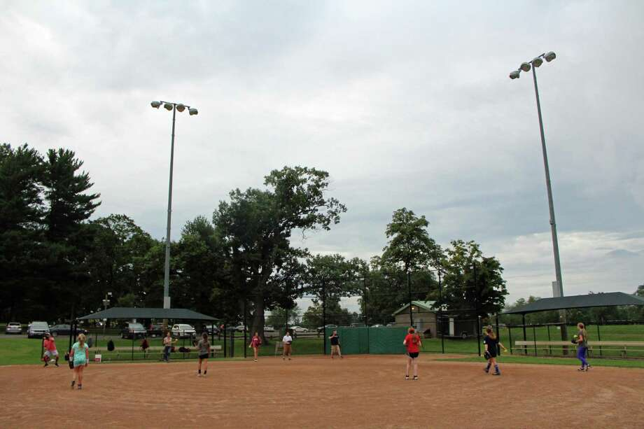 Large groups have been reported to Town of New Canaan Recreation Director, Steve Benko, and others amid their failure to maintain social distancing in town parks, and on its fields to limit the spread of the coronavirus, and the COVID-19 disease. New Canaan High School softball players previously practice their pitches at Orchard Field in Waveny Park during a past season. Photo: Humberto J. Rocha / Hearst Connecticut Media / New Canaan News