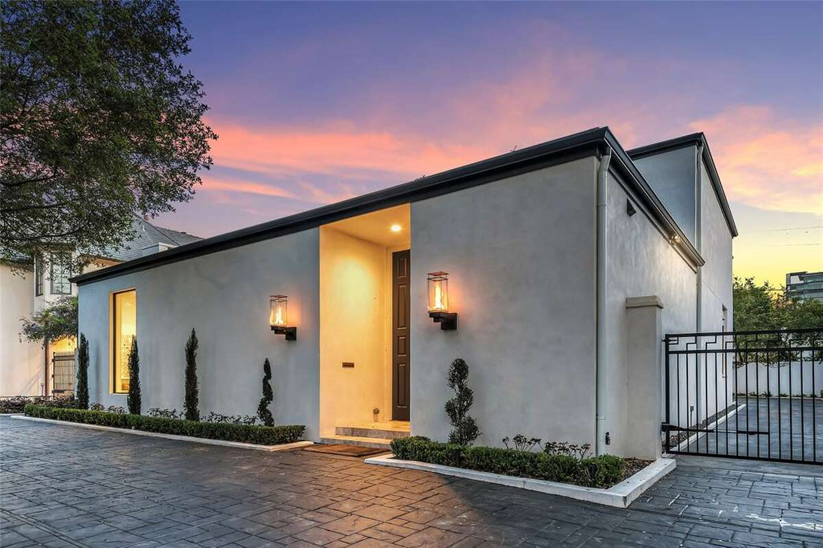 Located at3429 Ella Lee Lane, this sleek, mid-century modern home was designed by noted architect and longtime civic leader Preston Bolton. The four bedroom, four and a half bathroom home features an open floor plan with soaring ceilings, skylights andwalls of sliding glass doors that surround the stunning patio and pool. The original list price was$3,749,000; it is now listed for$3,649,500.