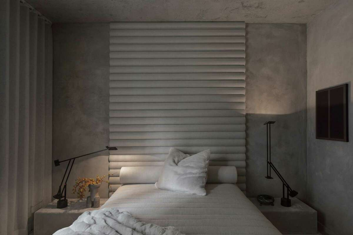 """A sleep-friendly bedroom is like a """"good snuggle,"""" one that makes you """"feel embraced and safe,"""" furniture designer and decorator Alex White says. Keep things """"tonal and tactile with as many luxurious materials as your budget allows."""""""