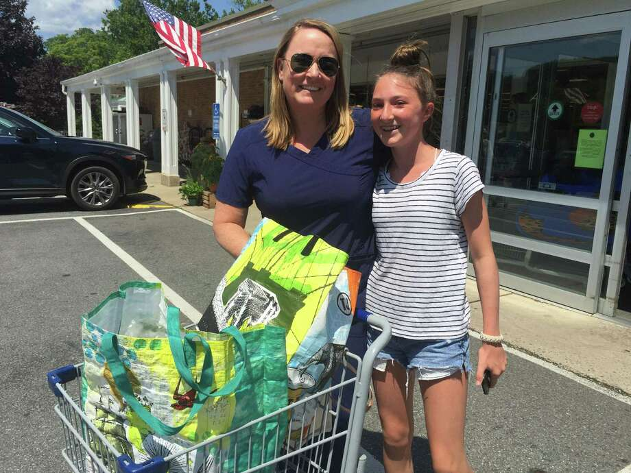 Kathy and Sophie Essig with their reusable bags at Village Market in Wilton. Photo: Patricia Gay /Hearst Media Connecticut