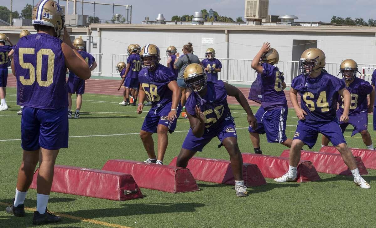 Midland High players run through drills 08/06/19 during evening practice at Memorial Stadium. Tim Fischer/Reporter-Telegram