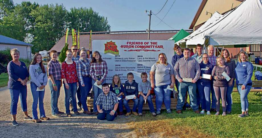 Frankenmuth Credit Union staff pose with the winners of this year's County Fair Youth Livestock grants at the Huron Community Fair. Photo: Submitted Photo