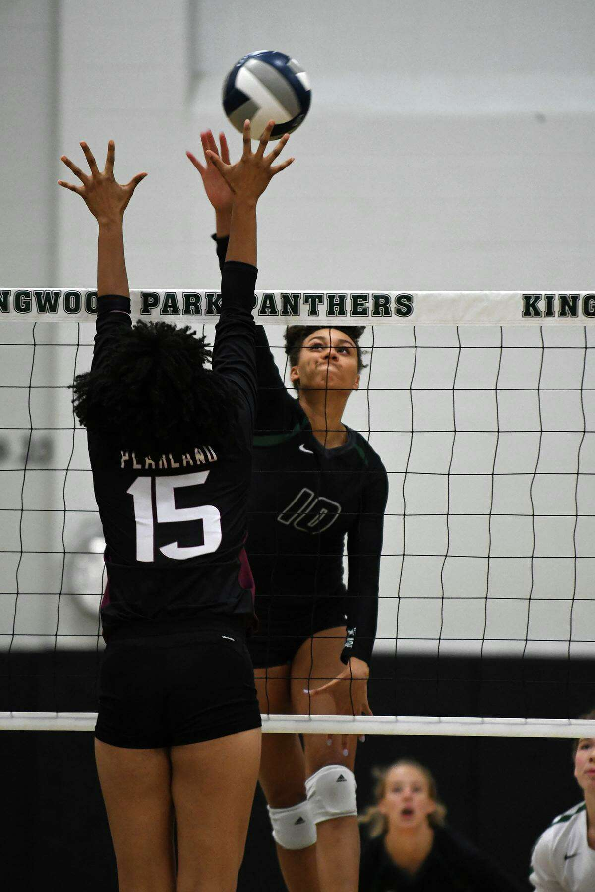 Kingwood Park's Erika Williams, right, makes a play against Pearland's April Conant (15) during their season-opening non-district match at Kingwood Park High School on August 6, 2019.