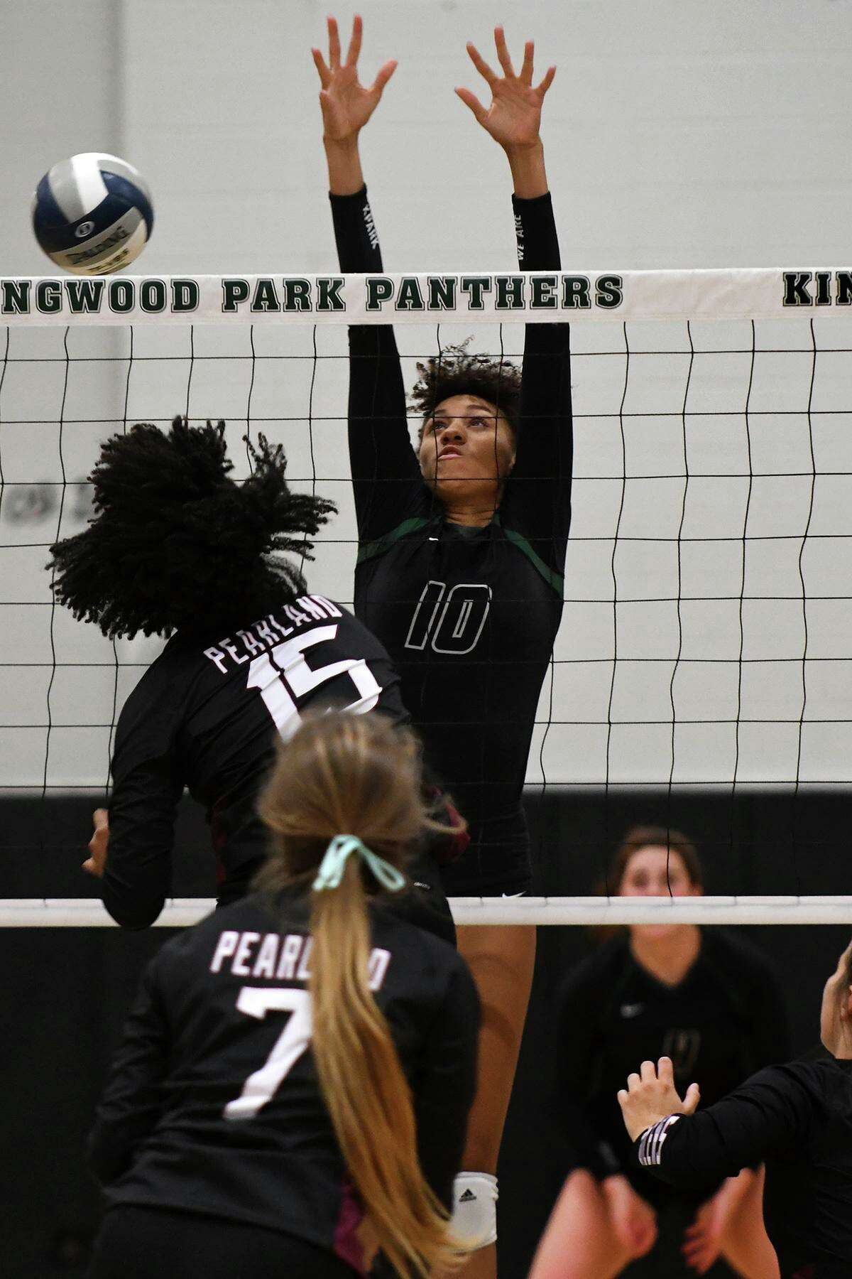 Kingwood Park's Erika Williams (10) works a for a block against Pearland's April Conant (15) during their season-opening non-district match at Kingwood Park High School on August 6, 2019.