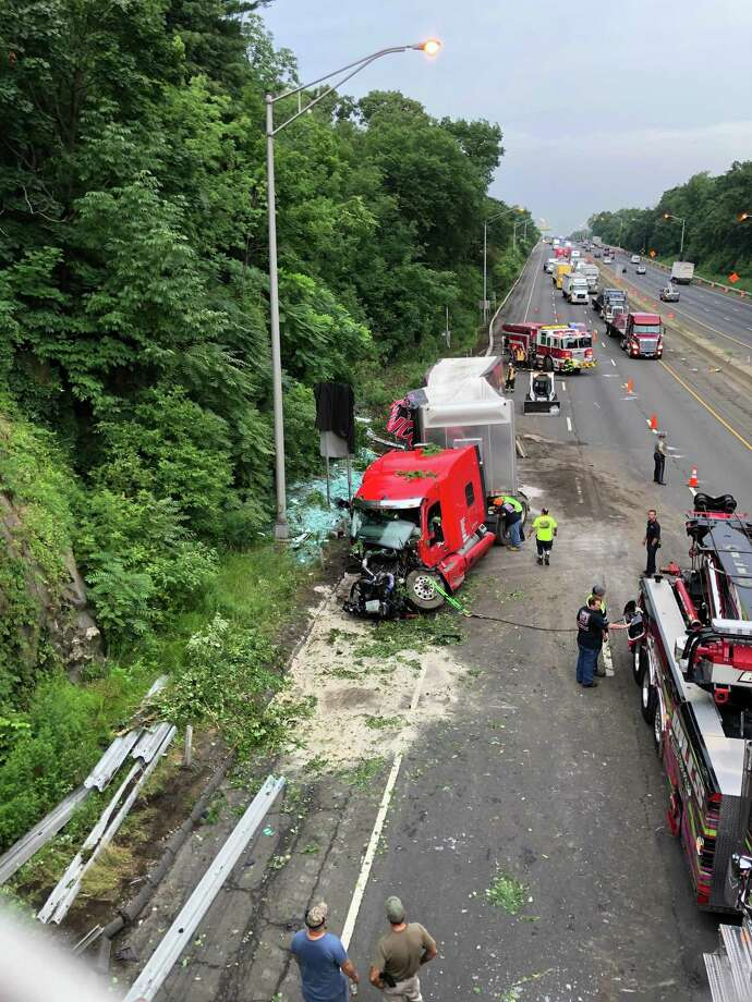 A crash involving a tractor-trailer carrying plate glass closed two lanes on I-95 North in Greenwich Wednesday morning. Photo: Wendy Wollins / Contributed