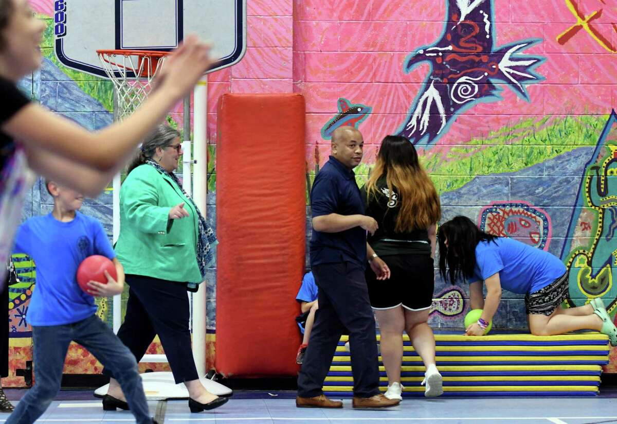 Assembly Speaker Carl Heastie, center, and Assemblymember Carrie Woerner, left, circumnavigate a lively dodgeball game while touring the Mechanicville Community Service Center on Wednesday, Aug. 7, 2019, in Mechanicville N.Y. (Will Waldron/Times Union)