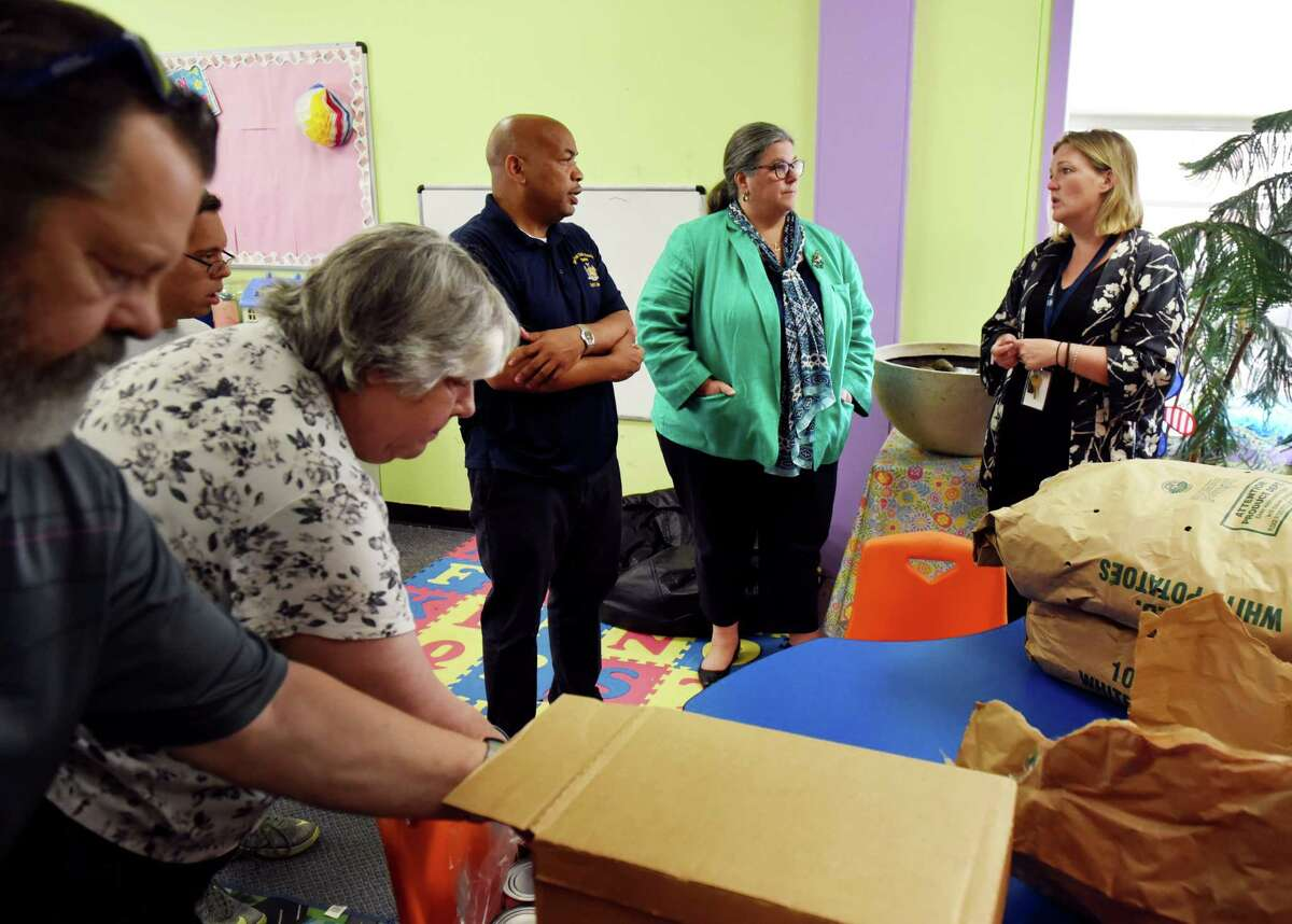 Assembly Speaker Carl Heastie, center left, and Assemblymember Carrie Woerner, center right, are given a a tour of the Mechanicville Community Service Center by Megan Quillinan, executive director, right, on Wednesday, Aug. 7, 2019, in Mechanicville N.Y. (Will Waldron/Times Union)