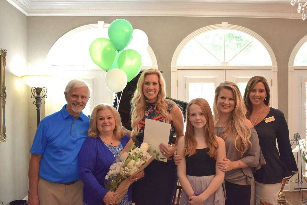 Five individuals, one business and one nonprofit organization have been selected as honorees this year in Interfaith of The Woodlands' Hometown Heroes program. Here, Mary-Lou Fitch accepts her award.