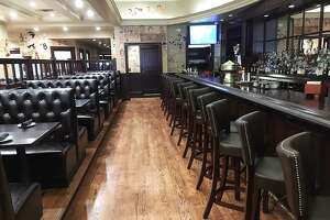 The renovated bar area at The Palm Restaurant in San Antonio features a widened aisle, brand new bar top and booths.