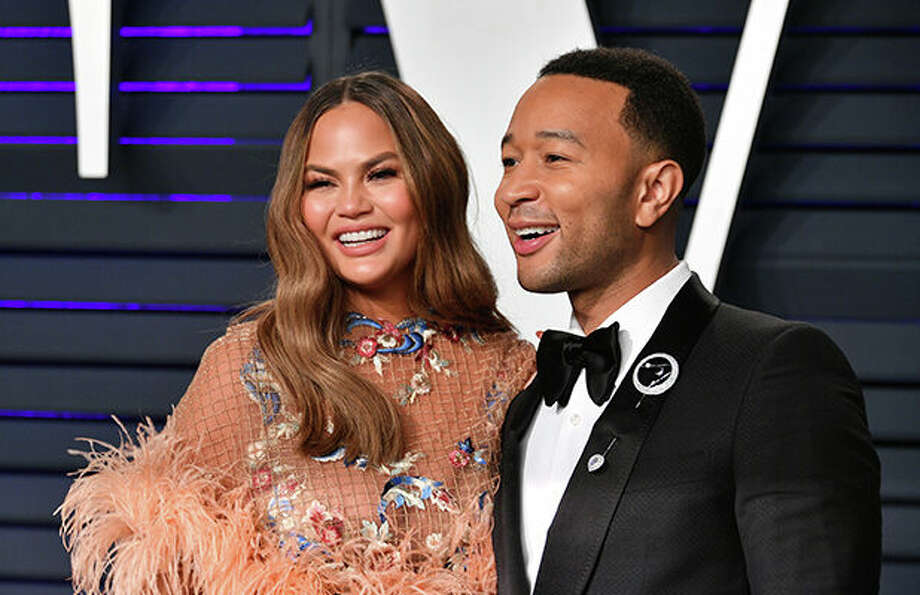 Chrissy Teigen (left) and John Legend attend the 2019 Vanity Fair Oscar Party hosted by Radhika Jones at Wallis Annenberg Center for the Performing Arts on February 24, 2019 in Beverly Hills, California. Photo: Dia Dipasupil / 2019 Getty Images
