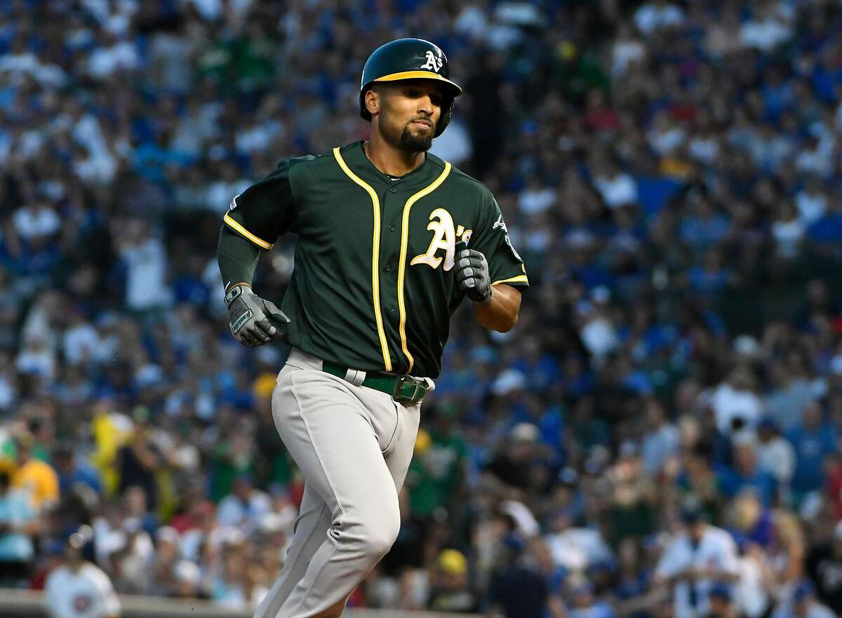 CHICAGO, ILLINOIS - AUGUST 05: Marcus Semien #10 of the Oakland Athletics runs the bases after hitting a two-run home run against the Chicago Cubs during the third inning at Wrigley Field on August 05, 2019 in Chicago, Illinois. (Photo by David Banks/Getty Images)
