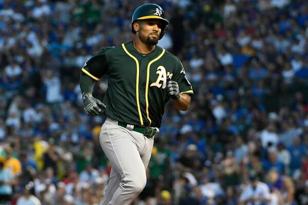 Semien, Bassitt, Phegley show A's came out ahead in 2014 Chicago deals