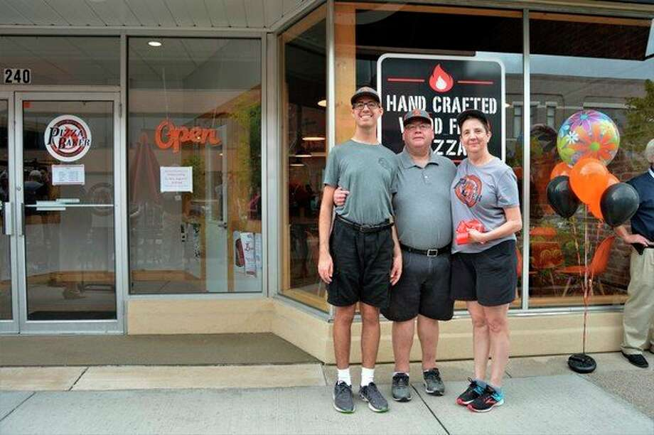 The Bakers, Jameson, Jim and Janet, celebrate the grand opening oftheir downtown eatery, Pizza Baker, located at 240 E. Main St. in downtown Midland. (Ashley Schafer/Ashley.Schafer@hearstnp.com)