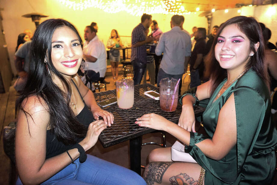 Monica Manrique and Leann Jimenez at The Happy Hour Downtown Bar Photo: Jose Gustavo Morales