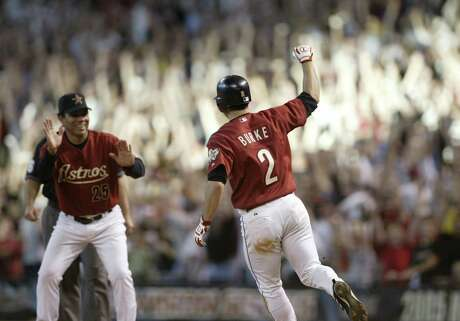 Chris Burke pumps his fist as he heads for first base after his walk-off home run in the 18th inning of Game 4 of the National League Division Series between the Houston Astros and the Atlanta Braves, at Minute Maid Park, Sunday, October 9, 2005. (Karen Warren/Houston Chronicle)     HOUCHRON CAPTION (10/10/2005) SECNEWS COLORFRONT:  GAME WINNER:  First base coach Jose Cruz cheers on Chris Burke as he rounds the base after his home run in the 18th inning.     HOUCHRON CAPTION (10/10/2005-2-STAR) SECNEWS COLORFRONT:  GAME WINNER:  Chris Burke pumps his fist after his home run in the 18th inning won the longest preseason game in baseball history.