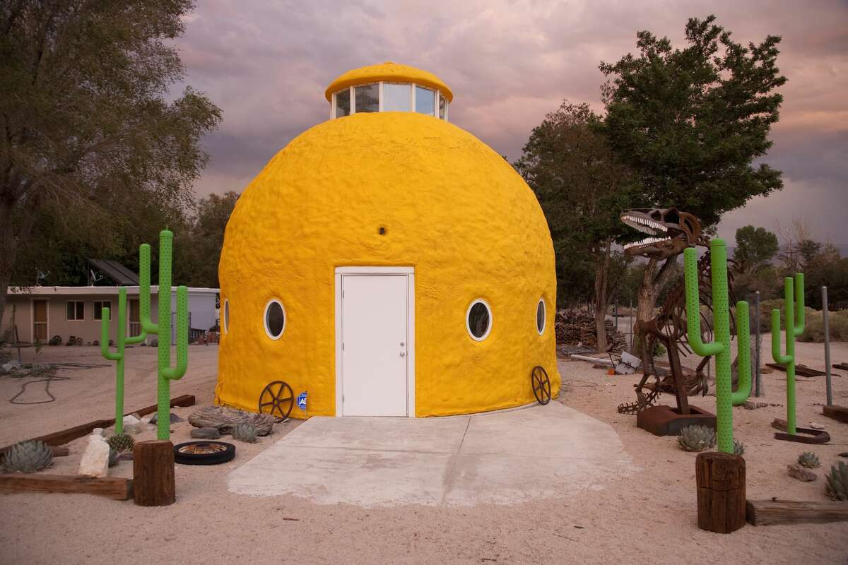 """ROUTE 395 """"Route 395 runs east of the Sierra Nevada mountain range and is full of superlatives,""""Visit California President and CEO Caroline Beteta says. One such stop is the big yellow dome on146 South Highway 395 in Cartago. The fun little stop has metal cacti and a T-rex skeleton."""