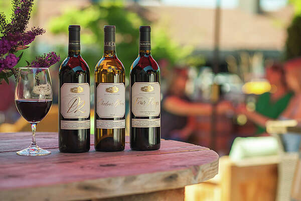 """DeLille Cellars: Nestled within a myriad of Woodinville wineries, DeLille Cellars, founded in 1992, and since developing over 200 wines rated 90+, is pouring out a tall glass of specials for the month of August. All of their wines are 10 percent off, and their 25th vintage is on sale for $37. Additionally, they're uncorkingdiscounted bundles and cases of their wines, with specialty Glassybaby candle holders and """"Heart Label"""" magnums, with proceeds benefiting uncompensated cancer care."""