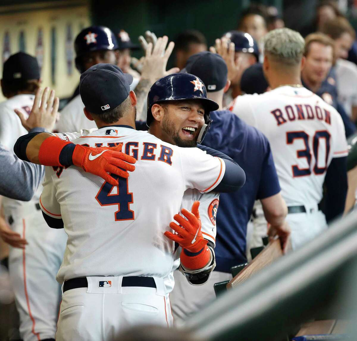 Houston Astros Yuli Gurriel (10) celebrates with George Springer (4) after hitting a three-run home run off of Colorado Rockies starting pitcher Peter Lambert during the first inning of an MLB baseball game at Minute Maid Park, Wednesday, August 7, 2019.