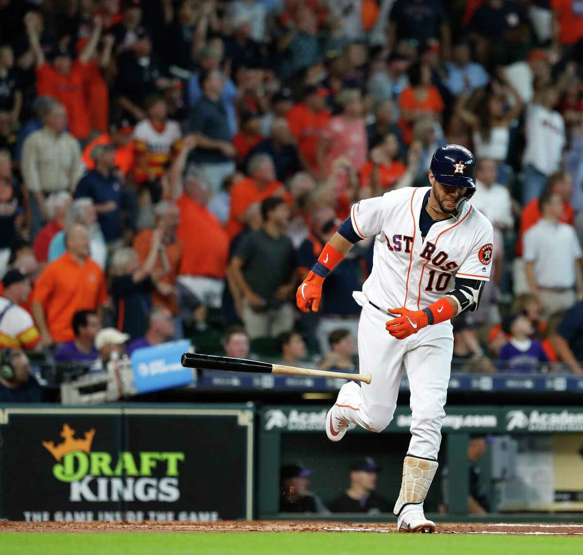 Houston Astros Yuli Gurriel (10) tosses his bat after hitting a three-run home run off of Colorado Rockies starting pitcher Peter Lambert during the first inning of an MLB baseball game at Minute Maid Park, Wednesday, August 7, 2019.