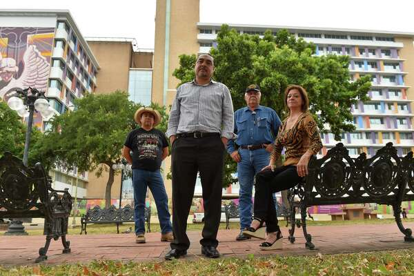 Rámon Vásquez, executive director of American Indians in Texas, second from left, along with Jesus J. Reyes Jr., left, Raymond Hernandez and Annette Losoya-Tynan stand in front of the Children's Hospital. Vásquez said Christus Santa Rosa worked with the group to alleviate concerns about ancestors' remains.