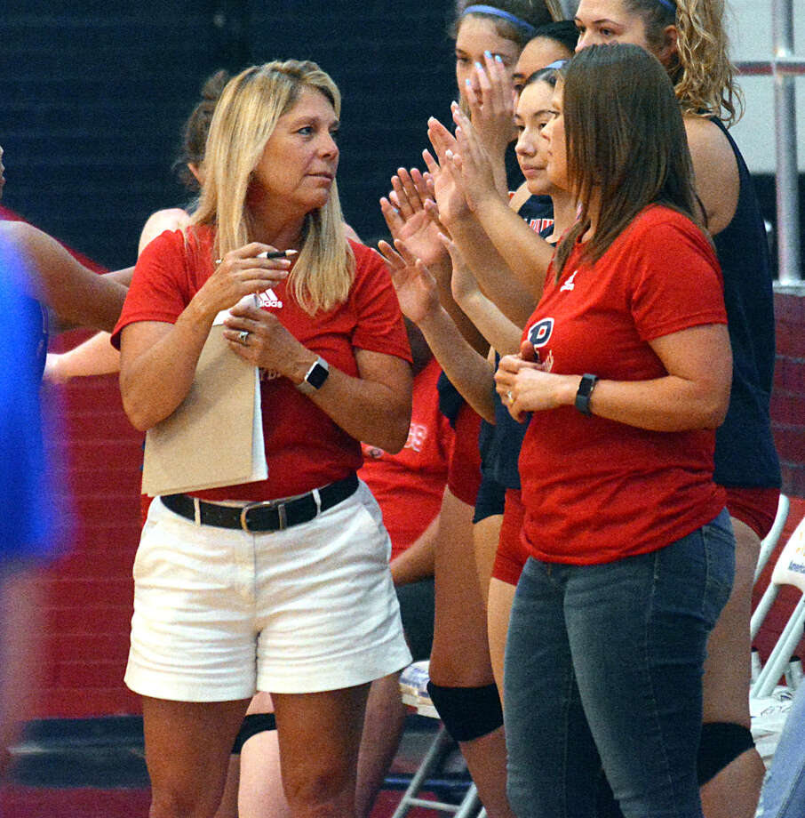 Plainview volleyball head coach Torri Hatch, left, earned her 200th career victory on Tuesday night. Hatch is in her 11th year leading the Lady Bulldogs. Photo: Nathan Giese/Planview Herald