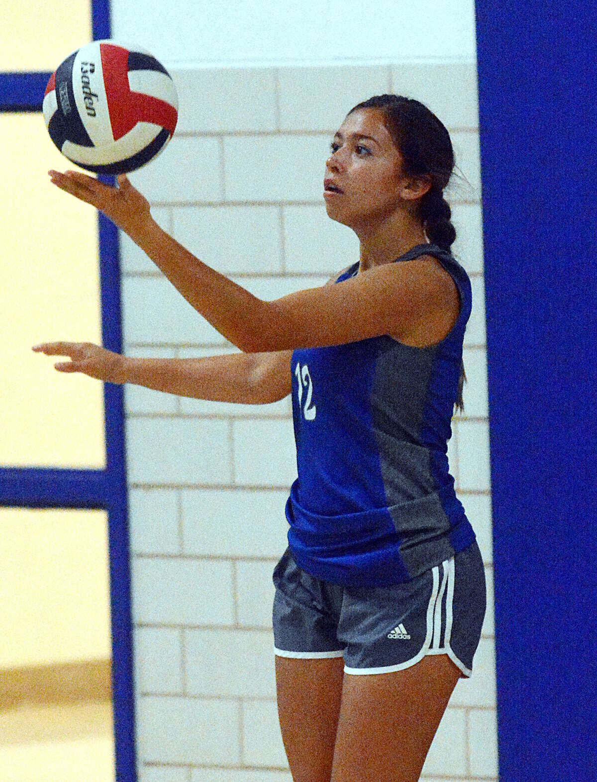 Olton's Celestte Ramirez gets ready to serve against Loop on Tuesday.