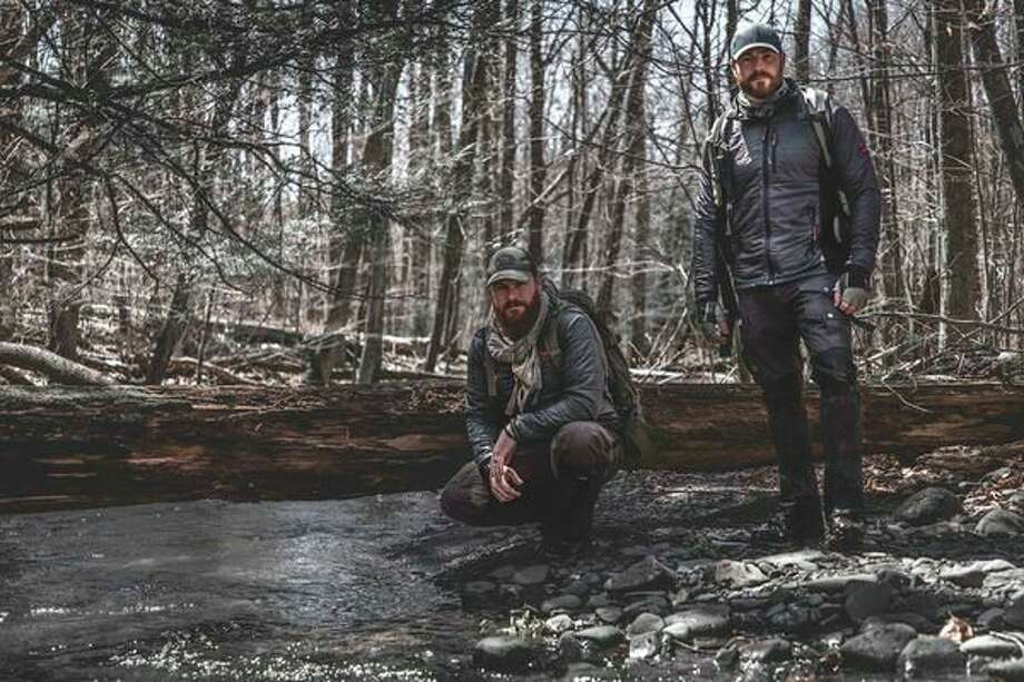 """Casey Keefer, left, and Chris Keefer pose for a photo to promote their new show on the Travel Channel """"Code of the Wild."""" (Photo provided/Chris Keefer)"""