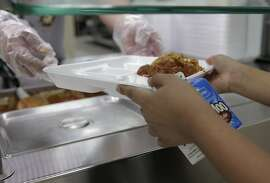 Fourth graders at Hancock Elementary School have their lunch served on Thursday, April 6, 2017, in Houston. The school offers a program where parents can put extra money in the funds so students who forget their lunch money get a full meal. ( Elizabeth Conley / Houston Chronicle )