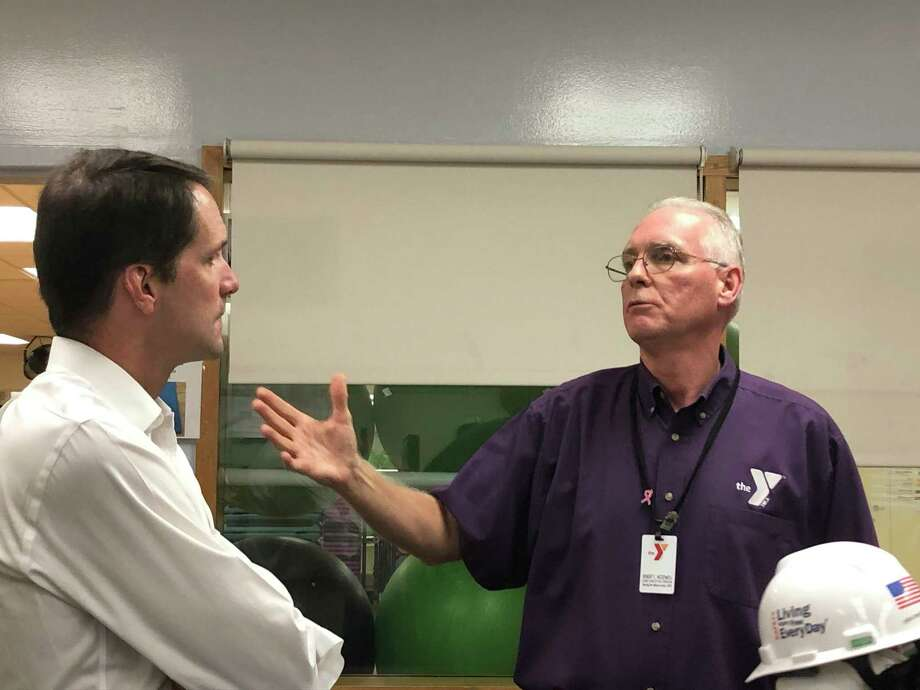 Congressman Jim Himes, left, listens at Riverbrook Regional YMCA CEO Bob McDowell discusses the Y's renovation project on Aug. 6. Photo: Contributed Photo / Riverbrook Regional YMCA
