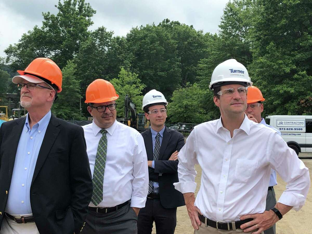 State Sen. Will Haskell, third left, and Congressman Jim Himes, fourth left, tour the expansion project of the Wilton Family YMCA.