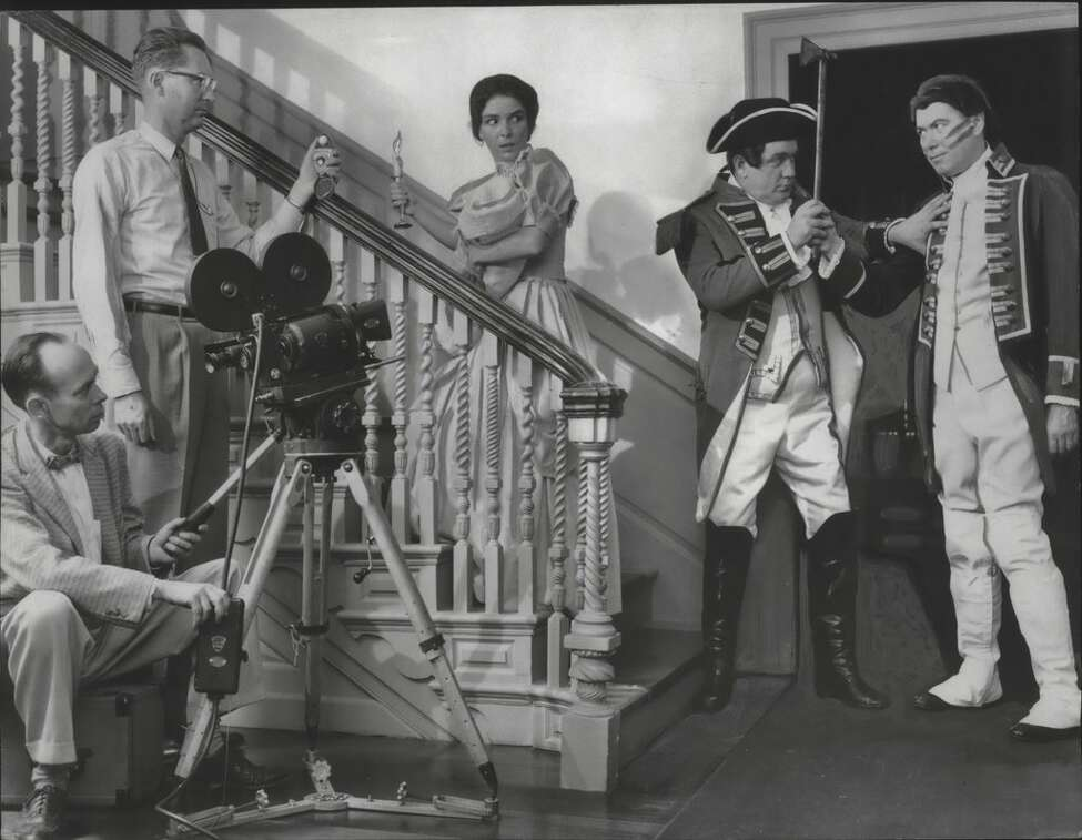 Actors for the State Department of Commerce reenact a raid on Schuyler Mansion in Albany, New York, as part of